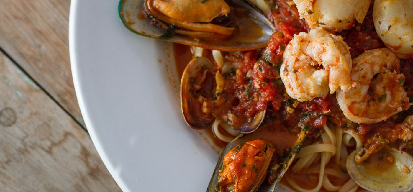 Zuppa De Pesce - Clams, Mussels, Shrimp, & Scallops, in a Red or White Sauce